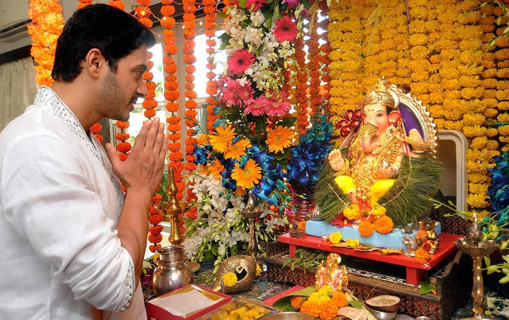 Bollywood actor Shreyas Talpade offers prayers to a Ganesh idol at his residence on the occasion of Ganesh Chaturthi, in Mumbai.
