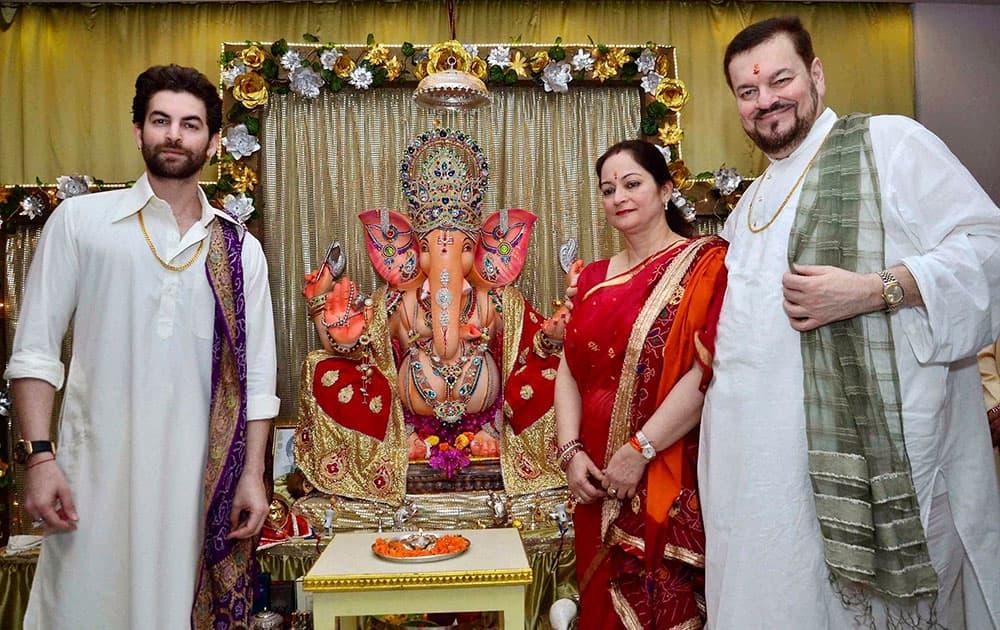 Singer Nitin Mukesh with his son actor Neill Nitin Mukesh celebrating Ganesh Chaturthi at their residence in Mumbai.