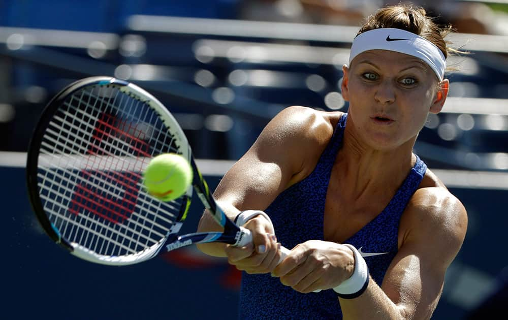 Lucie Safarova, of the Czech Republic, returns a shot to Alize Cornet, of France, during the third round of the 2014 US Open tennis tournament.
