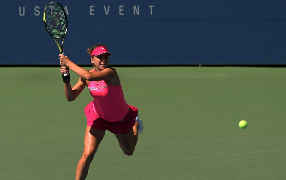 Belinda Bencic, of Switzerland, returns a shot to Angelique Kerber, of Germany, during the third round of the 2014 US Open tennis tournament.