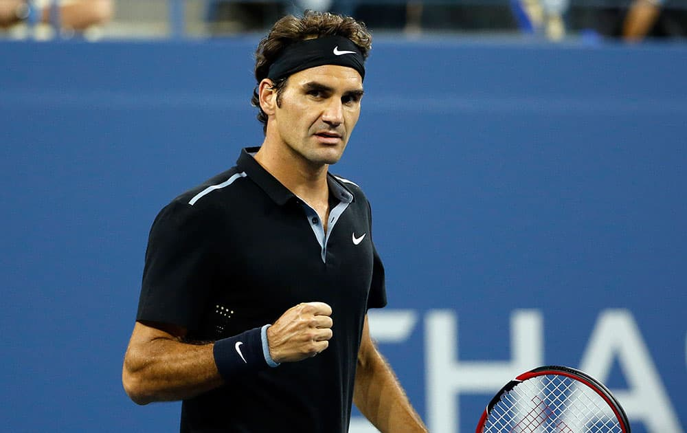 Roger Federer, of Switzerland, reacts after winning a point against Sam Groth, of Australia, during the second round of the US Open tennis tournament.