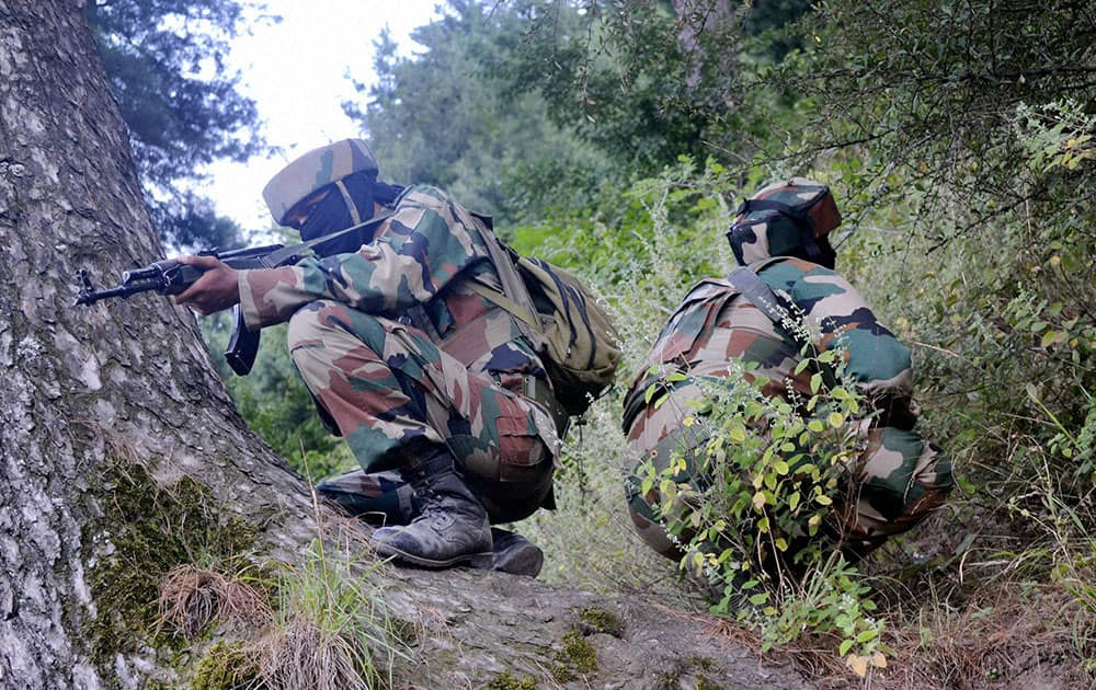 Army personnel taking position during an encounter with the militants at Baron Gali in Kalaro near the Line of Control (LOC) in Kupwara.