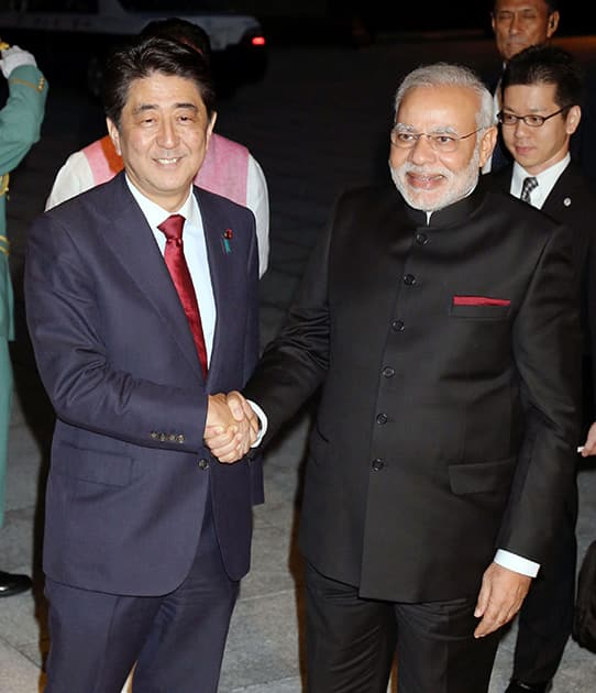 Prime Minister Narendra Modi, right, poses with his Japanese counterpart Shinzo Abe for photographers at State Guest House in Kyoto, western Japan.