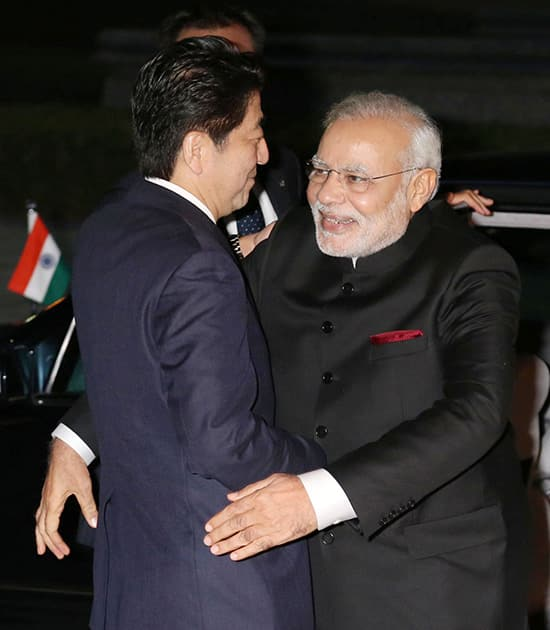 Prime Minister Narendra Modi, right, is welcomed by his Japanese counterpart Shinzo Abe upon arrival at State Guest House in Kyoto.