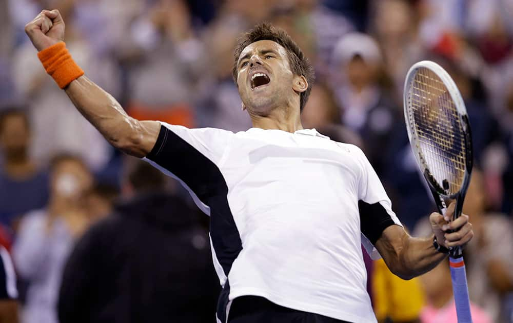 Tommy Robredo, of Spain, reacts after defeating Nick Kyrgios, of Australia, in the third round of the US Open tennis tournament.