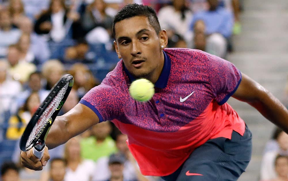 Nick Kyrgios, of Australia, reaches for a volley against Tommy Robredo, of Spain, during the third round of the US Open tennis tournament.