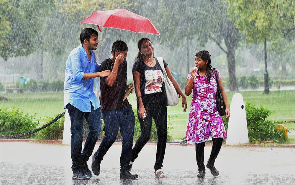 Youngster enjoying dip in temperature at Rajpath after rains lashed in New Delhi.