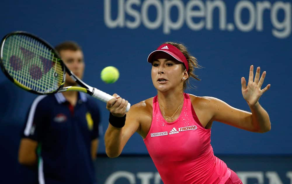 Belinda Bencic, of Switzerland, returns to Jelena Jankovic, of Serbia, during their match in the fourth round of the 2014 US Open tennis tournament.
