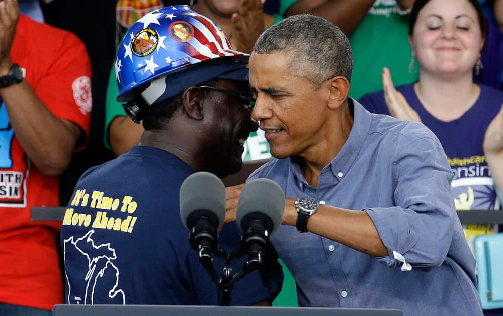 President Obama hugs Chris Harris, Vice President of United Steel Workers Local 2-209, after being introduced at Laborfest 2014 at Henry Maier Festival Park in Milwaukee.