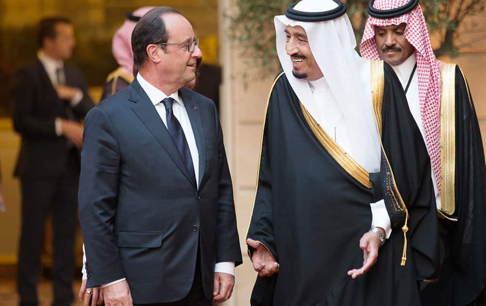 French President Francois Hollande, left, speaks with Defense Minister and Saudi Crown Prince Salman bin Abdul-Aziz prior to a dinner at the Elysee Palace in Paris.