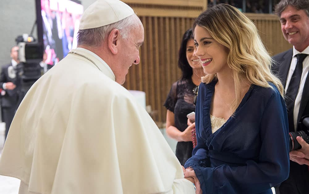 Pope Francis greets Argentine actress and singer Martina Stoessel, who portrays Disney Channel's