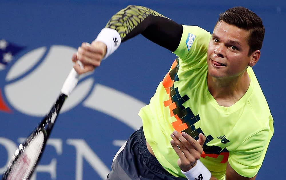 Milos Raonic, of Canada, serves to Kei Nishikori, of Japan, during the fourth round of the US Open tennis tournament.