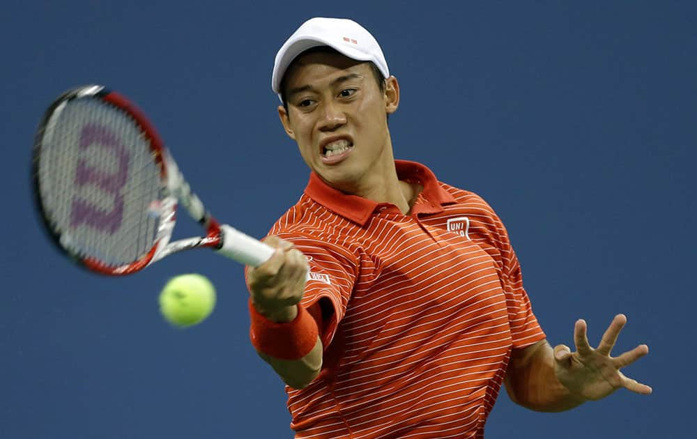 Kei Nishikori, of Japan, returns a shot to Milos Raonic, of Canada, during the fourth round of the 2014 US Open tennis tournament.