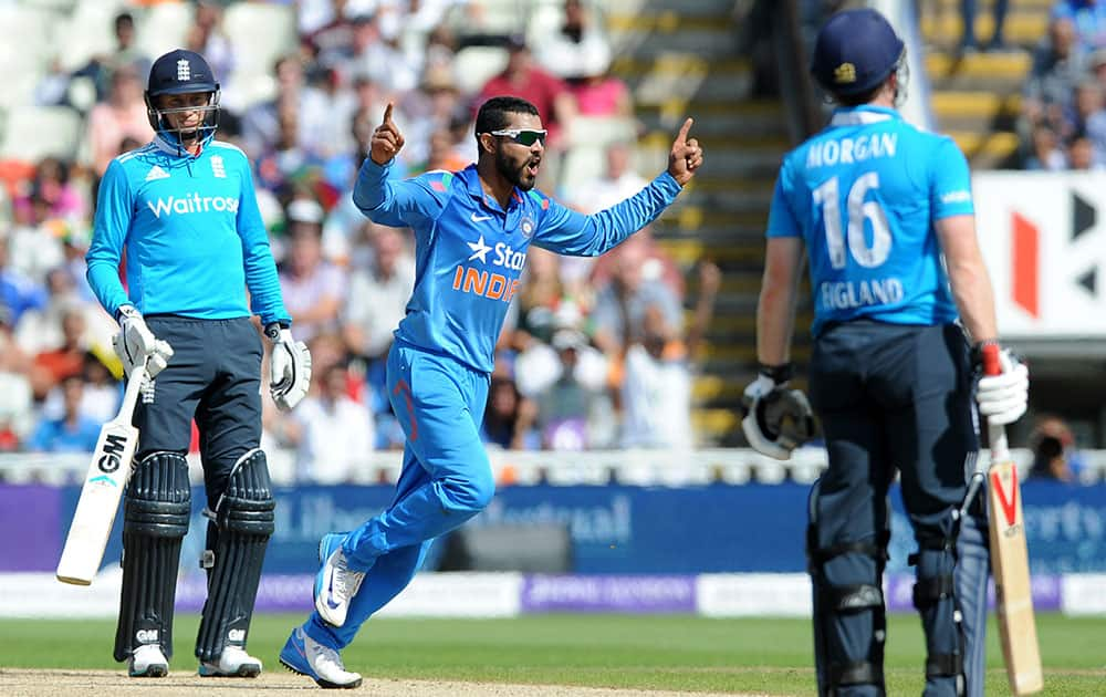 Ravindra Jadeja celebrates after bowling England's Eoin Morgan caught Suresh Raina for 32 runs during the fourth One Day International match between England and India at Edgbaston cricket ground, Birmingham.