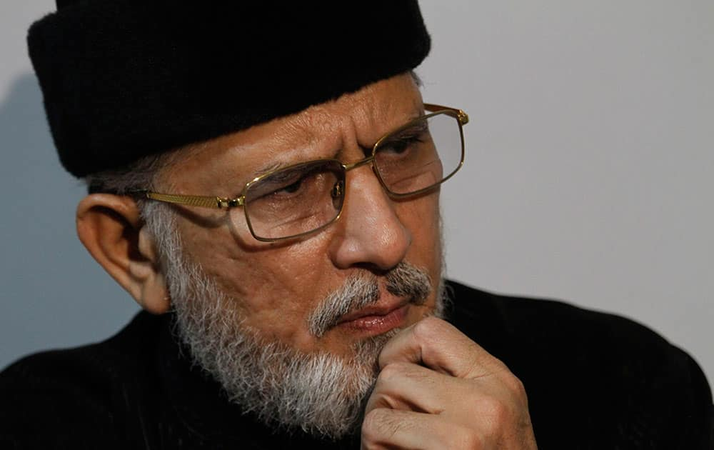 Pakistan's fiery cleric Tahir-ul-Qadri pauses during an interview with The Associated Press in Islamabad, Pakistan.