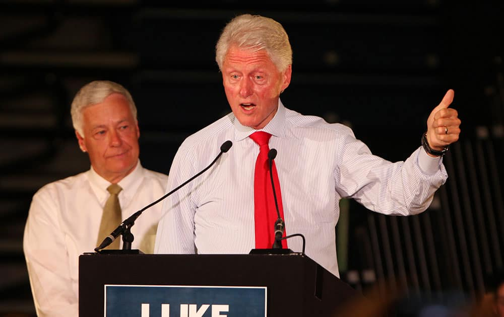 Former President Bill Clinton, joined by Rep. Mike Michaud, D-Maine, right, speaks, in Portland, Maine at a campaign rally for Michaud's campaign for governor.