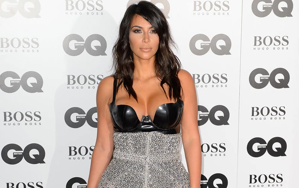 US socialite Kim Kardashian arrives for the GQ Men Of The Year Awards 2014 at a central London venue, London.