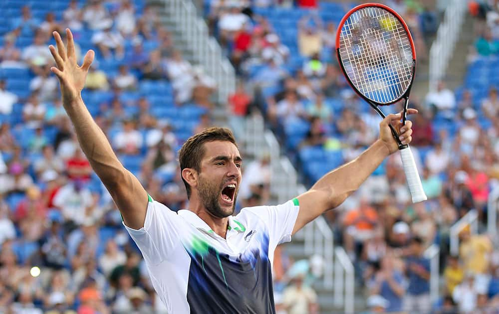 Marin Cilic, of Croatia, reacts after defeating Gilles Simon, of France, in five sets during the fourth round of the 2014 US Open tennis tournament.