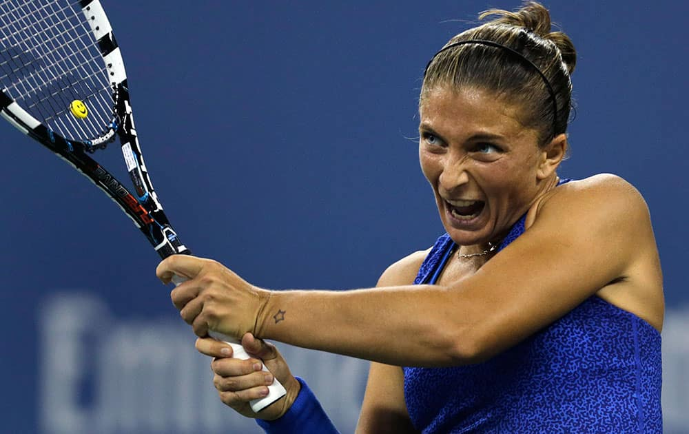 Sara Errani, of Italy, returns to Caroline Wozniacki, of Denmark, during the quarterfinals of the US Open tennis tournament.