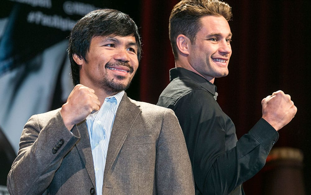 Boxers Manny Pacquiao, left, and Chris Algieri pose for a photo in Los Angeles.
