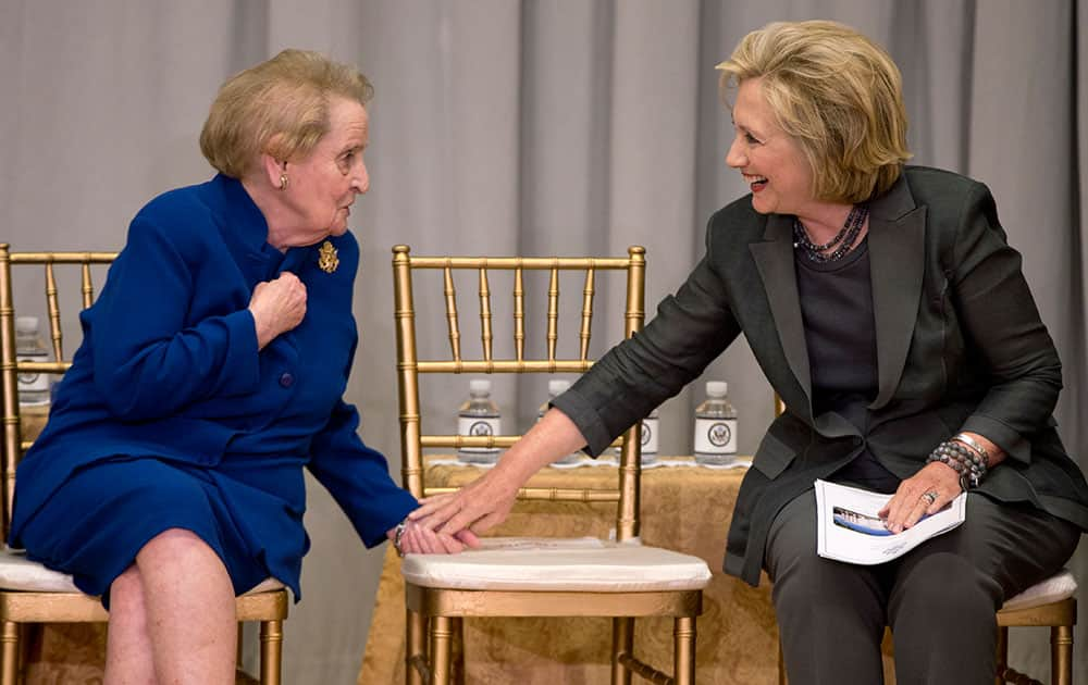 Former Secretaries of State Madeleine Albright, left, and Hillary Rodham Clinton talk during the groundbreaking ceremony for the US Diplomacy Center.