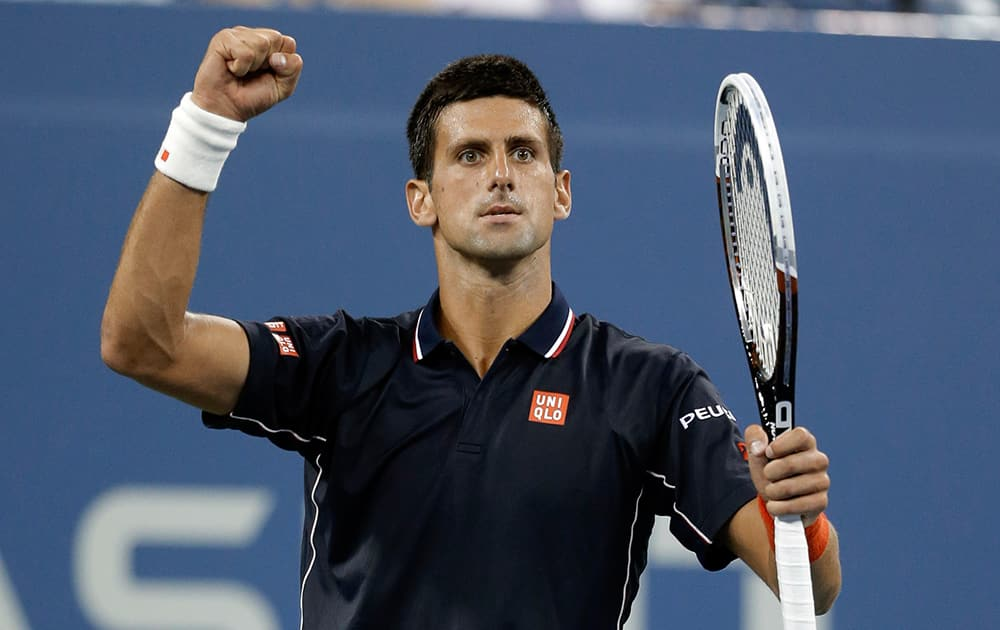 Novak Djokovic, of Serbia, reacts after winning a game against Andy Murray, of Britain, during the quarterfinals of the U. Open tennis tournament, in New York.
