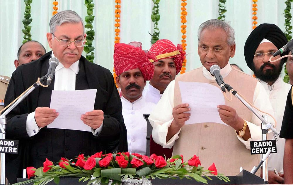 Chief Justice of Rajasthan High Court Sunil Ambwani administering him oath of office to the new Governor Kalyan Singh at a swering-in -ceremony at Raj Bhawan in Jaipur.