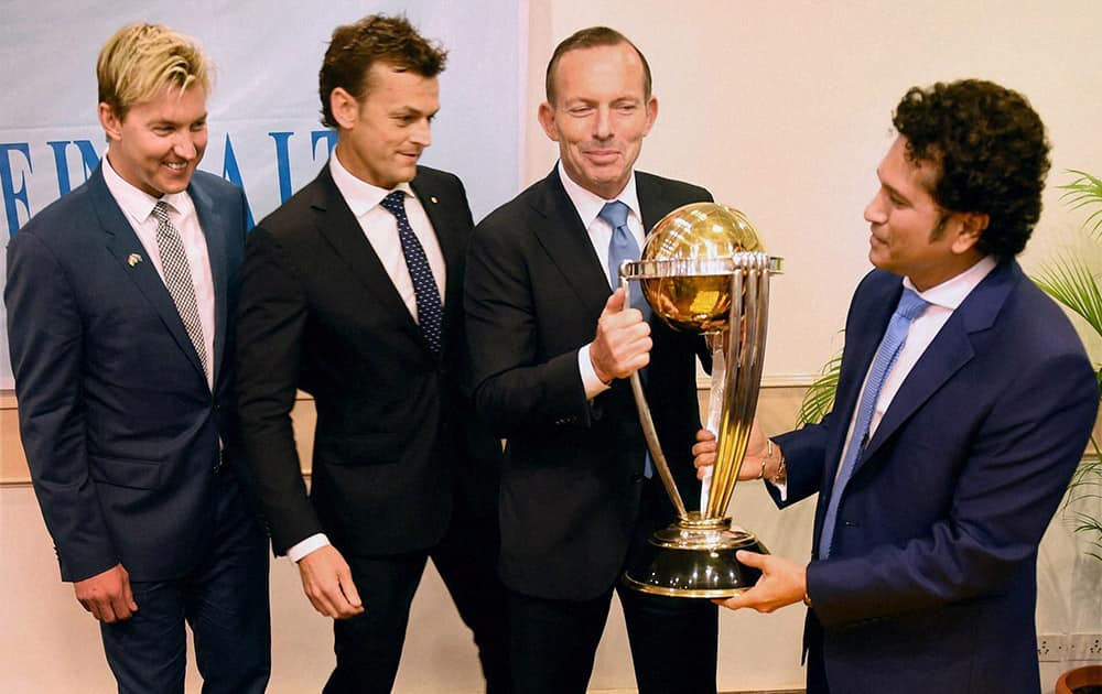 Australian Prime Minister Tony Abbott, legendary cricketer Sachin Tendulkar and former Australian cricketers Adam Gilchrist and Brett Lee with the Cricket World Cup trophy during a sporting event organised by Australian Consulate at Cricket Club of India (CCI) in Mumbai.