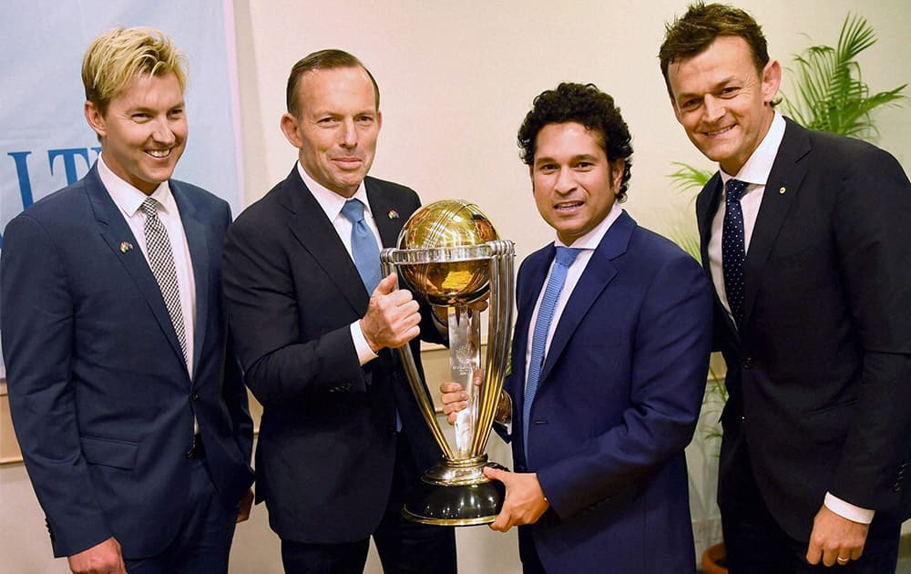 Australian Prime Minister Tony Abbott and legendary cricketer Sachin Tendulkar flanked by former Australian cricketers Adam Gilchrist and Brett Lee pose with the Cricket World Cup trophy during a sporting event organised by Australian Consulate at Cricket Club of India (CCI) in Mumbai.