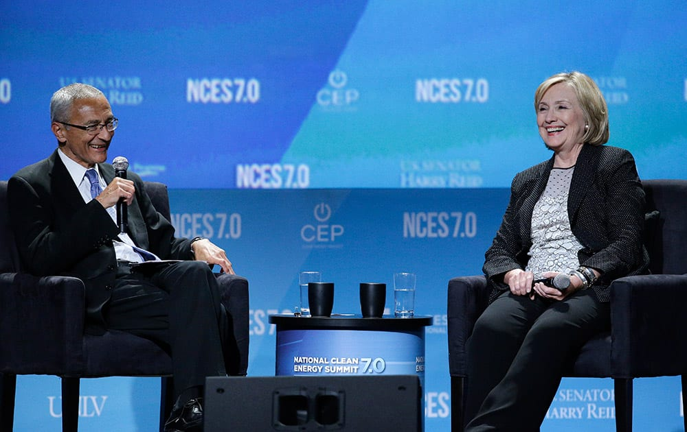 Former Secretary of State Hillary Rodham Clinton, right, takes questions from John Podesta, counselor to President Barack Obama, at the National Clean Energy Summit.
