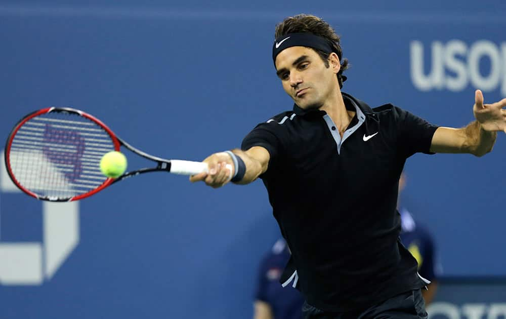 Roger Federer, of Switzerland, returns to Gael Monfils, of France, during the quarterfinals of the US Open tennis tournament, in New York.
