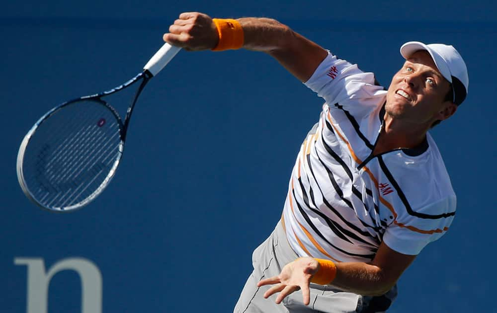 Tomas Berdych, of the Czech Republic, serves against Marin Cilic, of Croatia, during the quarterfinals of the 2014 US Open tennis tournament.