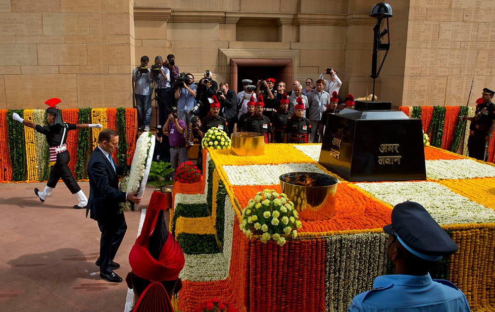 Australian Prime Minister Tony Abbott pays tribute at the India Gate war memorial monument in New Delhi.