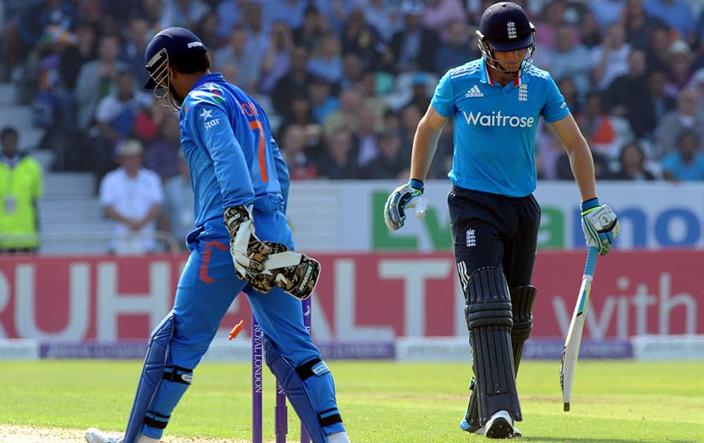 England's Jos Buttler is run out by India's M S Dhoni during the fifth One Day International match between England and India at Headingley cricket ground, Leeds, England.