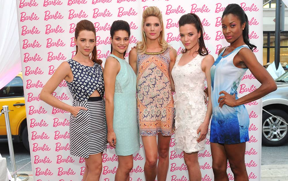 Models wearing Barbie-inspired fashions from CFDA designers strike a pose at the Barbie and CFDA Fashion Lounge VIP Party during New York Fashion Week