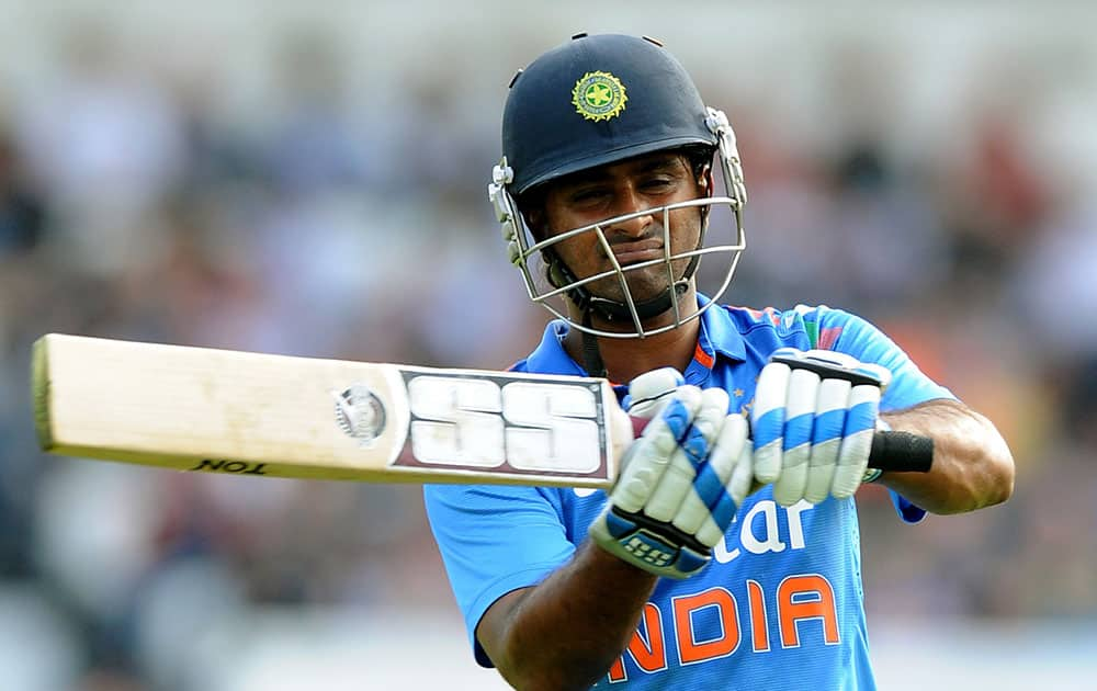 India's Ambati Rayudu reacts after being bowled by England's Ben Stokes caught Alastair Cook for 53 runs during the fifth One Day International match between England and India at Headingley cricket ground, Leeds.