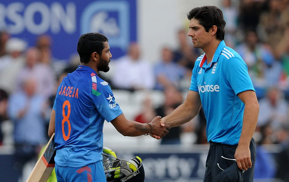 India's Ravindra Jadeja, left, shakes hands with England captain Alastair Cook after England beat India by 41 runs but lose the series 3-1 during the fifth One Day International match between England and India at Headingley cricket ground.