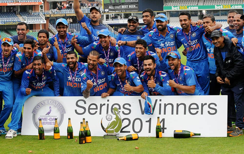 India players celebrate defeating England 3-1 to win the series after their fifth One Day International match at Headingley cricket ground, Leeds.