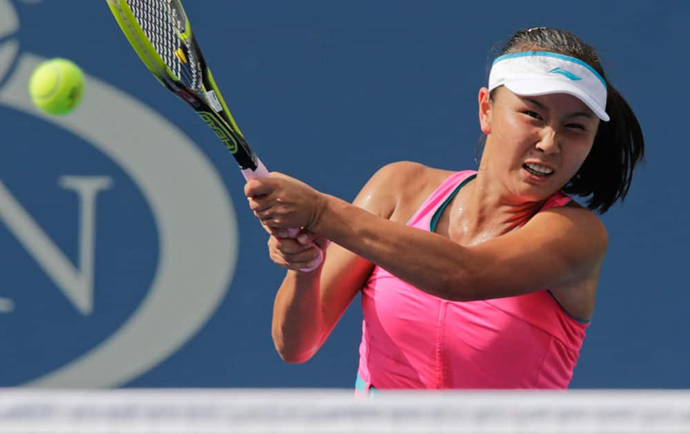 Peng Shuai, of China, returns a shot against Caroline Wozniacki, of Denmark, during the semifinals of the 2014 US Open tennis tournament.