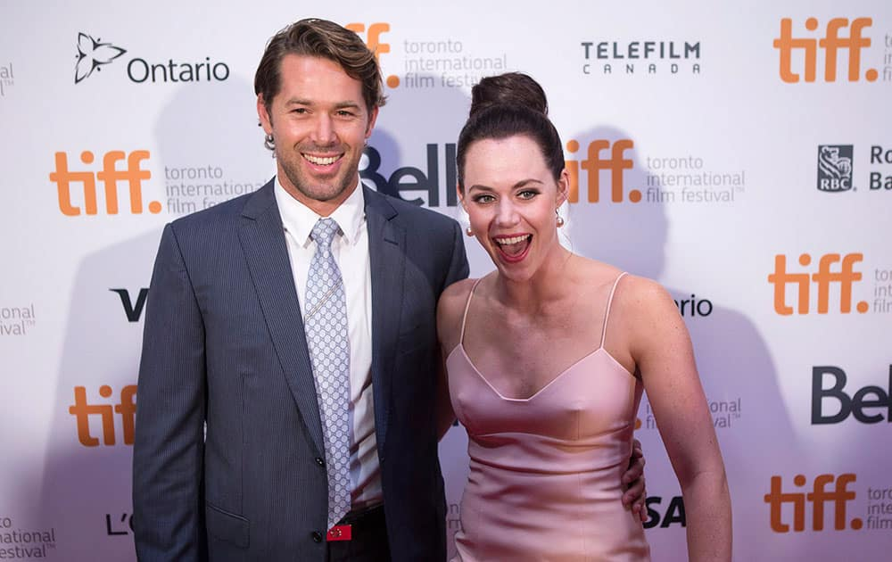 Tessa Virtue, right, and Ryan Semple arrive on the red carpet at the 3rd Annual Charity Gala during the 2014 Toronto International Film Festival in Toronto.