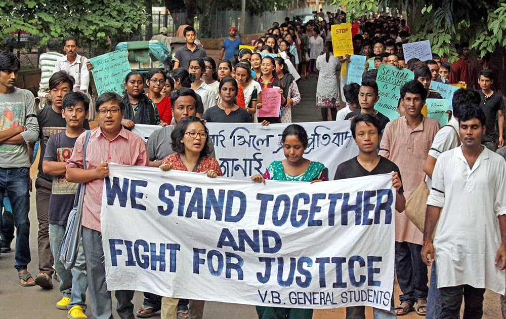 Students of Visva Bharati University walk in a silent rally asking for justice in a recent case of sexual molestation of a student of the university, in Santiniketan.