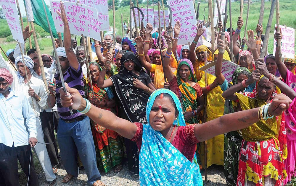 Villagers block Allahabad-Mirzapur State Highway during a protest against land Acquisition for NTPC power project at Kachari village in Allahabad.