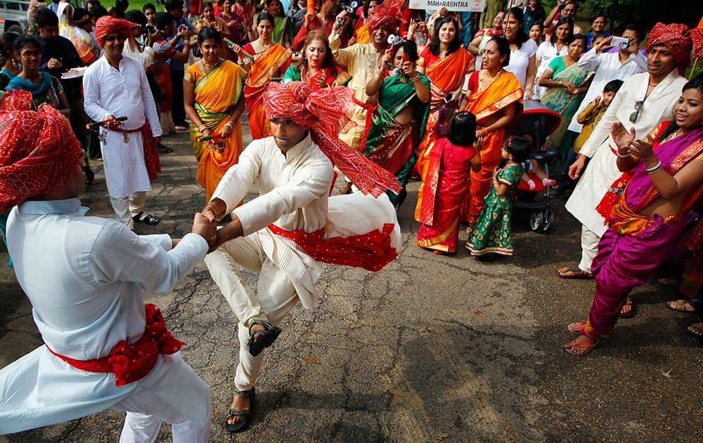 Dancers spin in a circle during the Ganesh Festival at the Indian Cultural Center in Eads, Tenn.