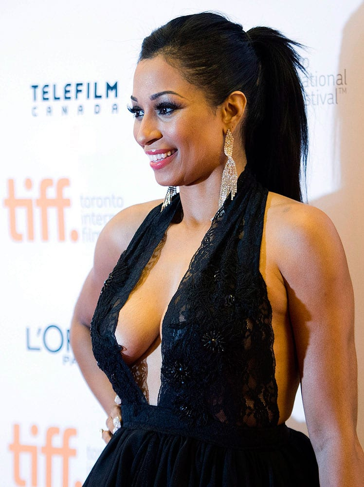 Actress Karlie Redd poses on the red carpet for her new movie ` Top Five` during the 2014 Toronto International Film Festival.
