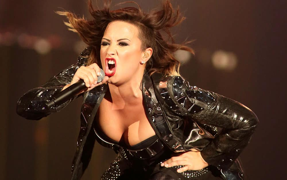 Singer Demi Lovato performs in concert during the opening night of her `Demi World Tour 2014` at the Baltimore Arena.