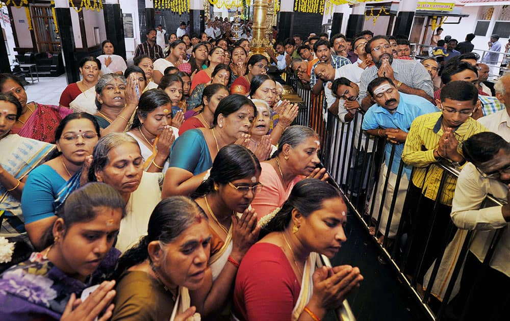 Devotees offering prayers at the Ayyappan Temple on the occasion of Onam in Coimbatore on Sunday.