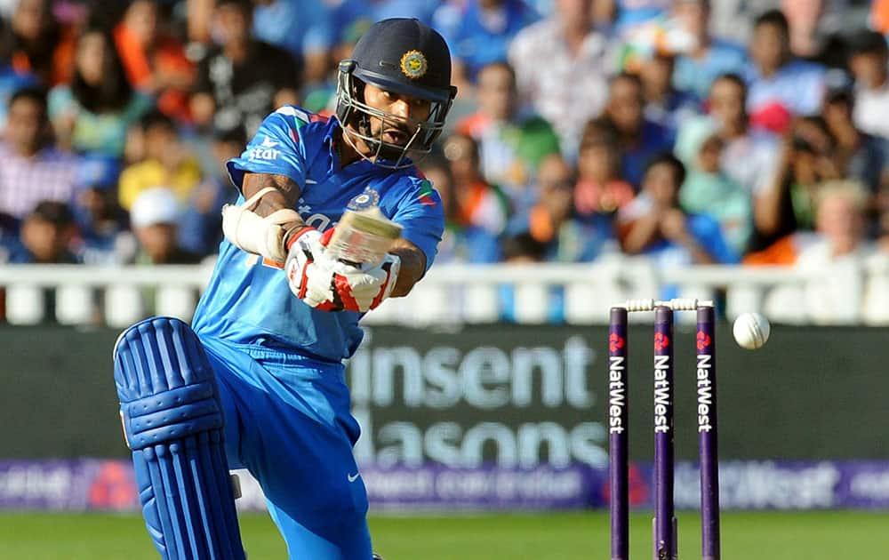 India's Shikhar Dhawan plays a shot during the International T20 match between England and India at Edgbaston cricket ground, Birmingham, England.
