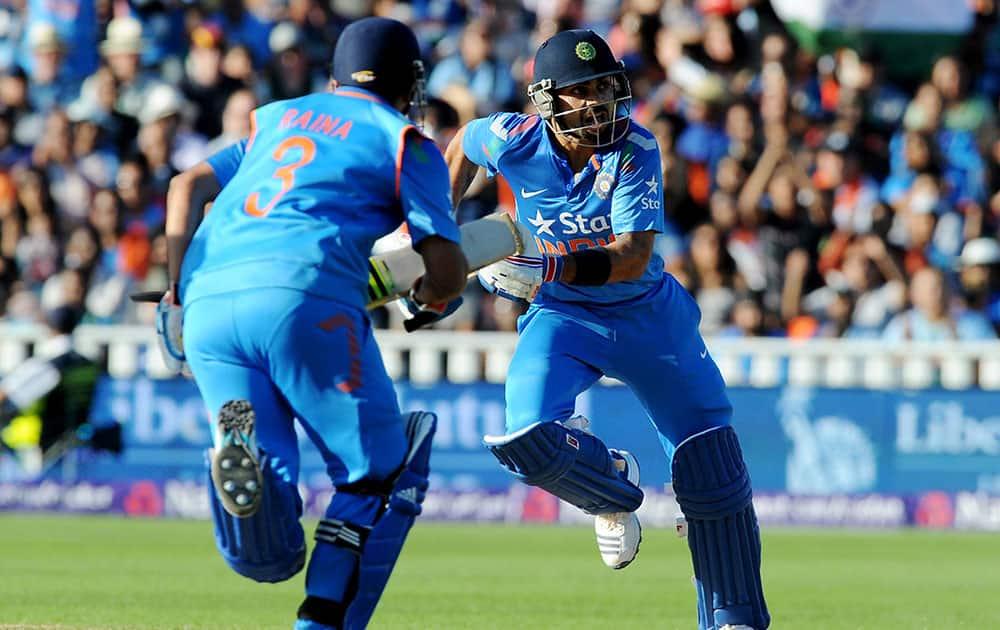 India's Virat Kohli, right, runs during the International T20 match between England and India at Edgbaston cricket ground, Birmingham, England.