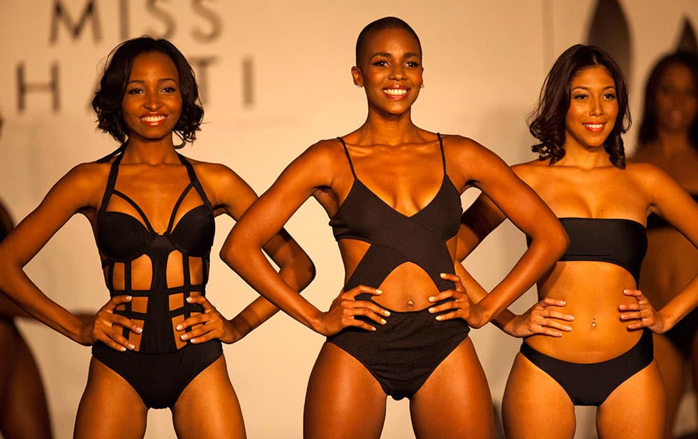 Contestants, Shamma Dupre, from left, Carolyn Desert, and Zeila Legagneur compete in the swimsuit category of the 2014 Miss Haiti beauty pageant at the Karibe Convention Center in the upscale Petionville district of Port-au-Prince, Haiti.