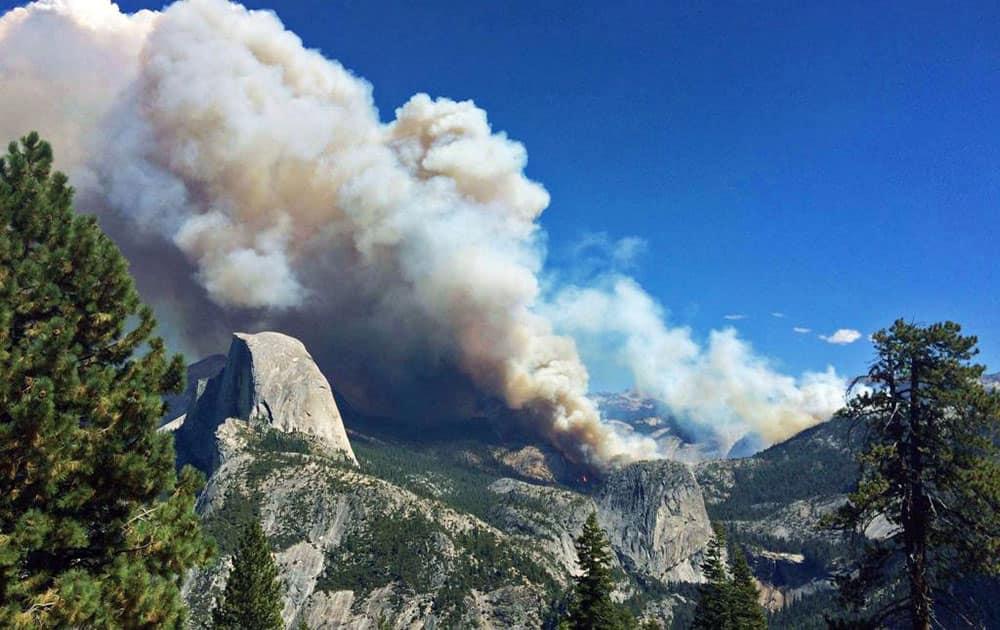 Smoke from a fire rises above Little Yosemite Valley near Yosemite National Park, Calif.